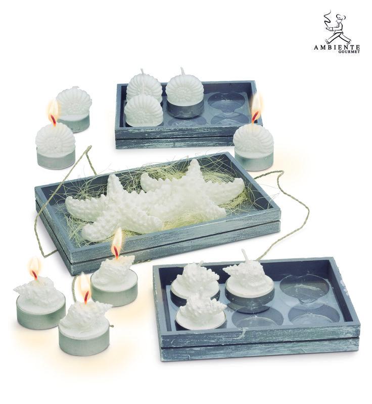 #velas en formas de #estrella de mar y #conchas para decorar la mesa alrededor de los platos o para iluminar la mesa de los aperitivos.