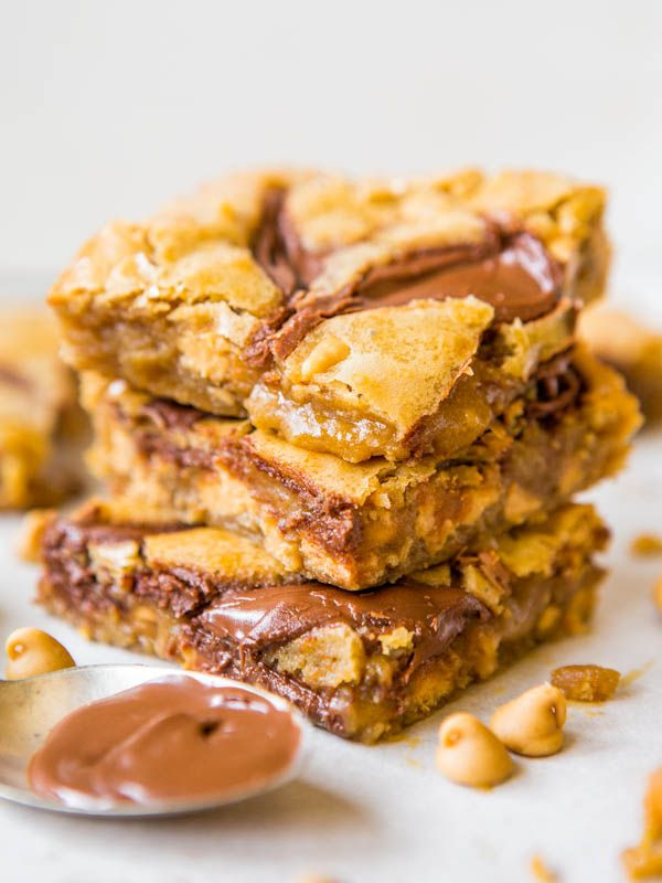 Nutella-Swirled Peanut Butter Chip Blondies - One bowl, no mixer, soft & gooey. Peanut Butter & Nutella is always a win! Easy Recipe at averiecooks.com