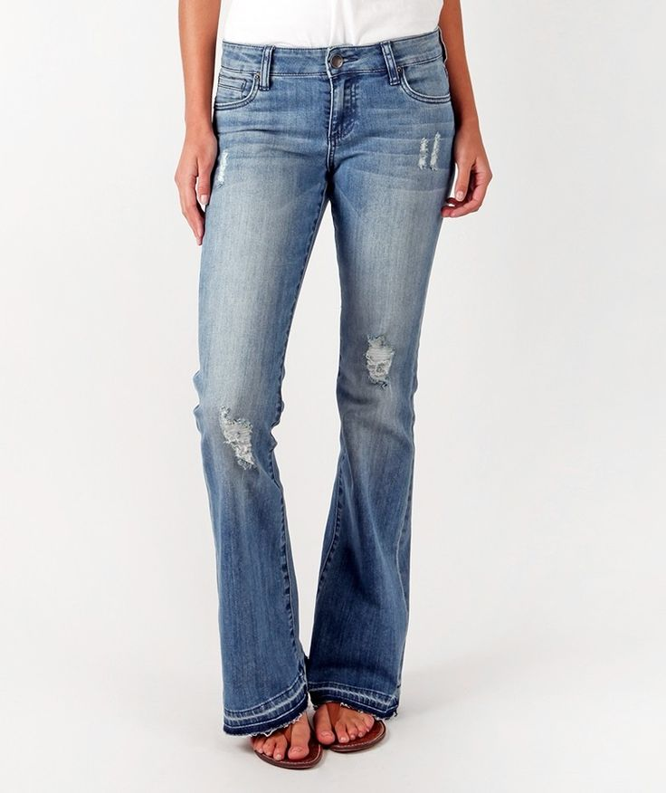 Our new super flare with a sexy, exaggerated leg. Super soft + flattering. Complete with shredded holes + heavily faded wash.  Details & Care: Medium Weight Denim  Great for Curvy Hips Vintage Vibe Super Flare Machine Wash Cold 99% Cotton / 1% Spandex
