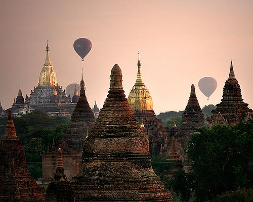 Hot air balloons rise above the sunrise in Mandalay, Myanmar (Burma). #travel #WOWattractions