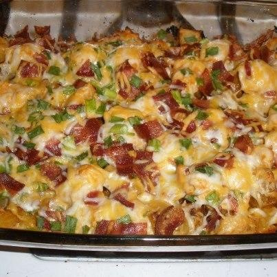 """Loaded Potato And Buffalo Chicken Casserole Recipe - I call this Cardiac Casserole... even my 13 yr. old had to laugh that there's a link to """"healthier recipes"""" halfway down the page. But it's GOOD! Made it last night. I sauteed the chicken before adding, I couldn't bear to put raw chicken on top of cooked potatoes."""