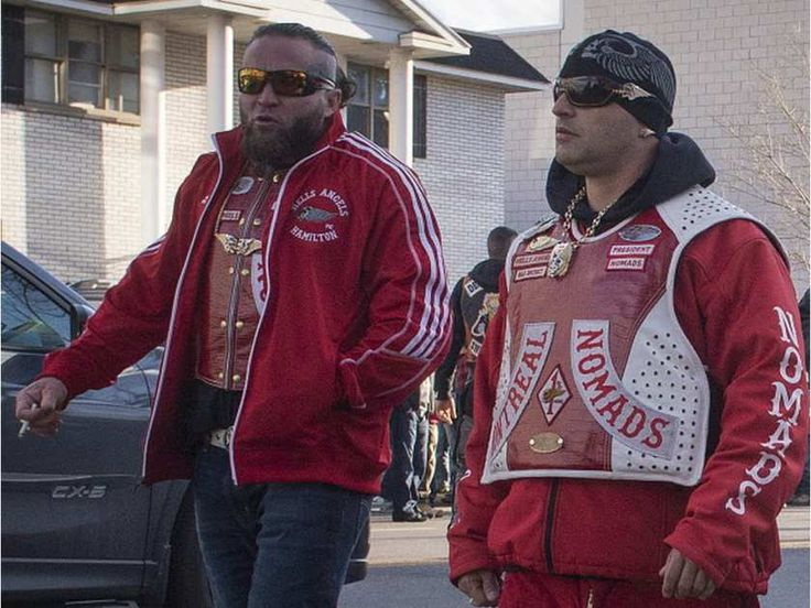 Nomads motorcycle club members Philippe Boudreau (left) and Martin Bernatchez leave the Alfred Dallaire Funeral Home in Repentigny as they walk to the church for the funeral service of 63-year-old Lionel Deschamps, a member of Hells Angels Montreal chapter, Saturday, November 7, 2015. Boudreau was shot in Lachute April 16, 2016.