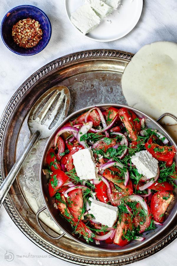 mediterranean fresh herbs and tomato salad.