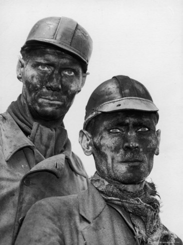 Life Magazine ::   Ruhr Valley, Germany    Grimy-faced German coal miner posing resolutely outside the coal mine where he hopes post-war management will not close out his job, in the Ruhr Valley.         Location:    Gelsenkirchen, Germany        Date taken:    1945        Photographer:    Margaret Bourke-White