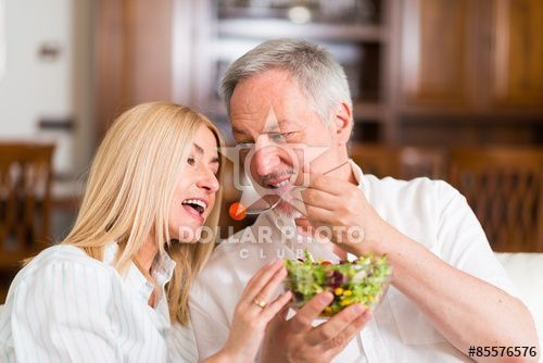 Mature couple eating a salad