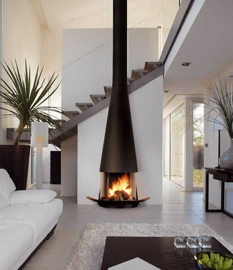 The Fireplace Is The Focal Point. There Is A Big Contrast From The Mostly  White Room And The Dark, Somewhat Shiny Fireplace. The Partial Wall Behind  It Also ...
