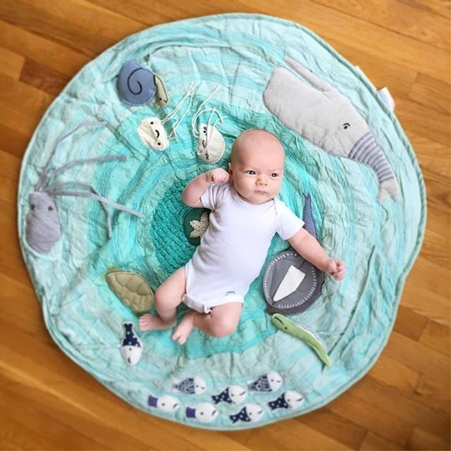 Marine themed baby activity mat lets your baby explore the wonders of the seven seas from the comfort of the nursery. It features a school of appliqued and embroidered sea creatures, rouched fabric for a wavelike texture and soft padding for extra comfiness. Baby-sized snorkel and fins are not needed. via @kellycroninphoto