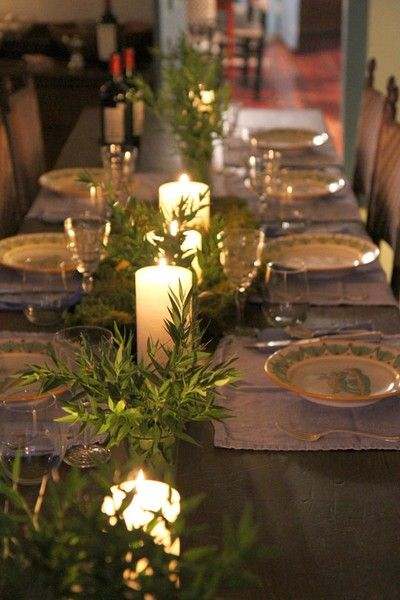 Simple olive branches and candlelight.   Rosemary branches would work also and smell so divinely Italian!