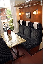 Seats resembling an old fashioned railway carriage at the Station Bistro, Wymondham - a very special place to eat out!