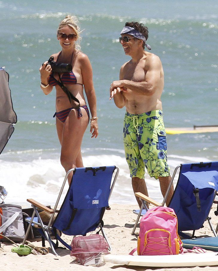 Pin for Later: Jet Set With the Best Celebrity Vacations  Shirtless Ben Stiller and his wife, Christine Taylor, hit the beach in August 2012 while in Kauai with family and friends.