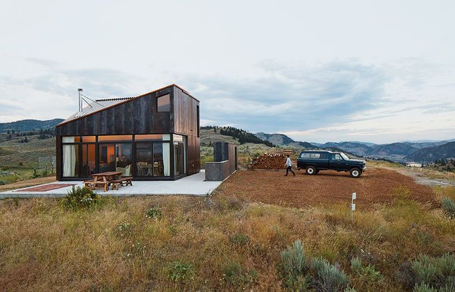 Architect Jesse Garlick's rural Washington vacation home references its rugged surroundings. The steel claddinghas developed a patina similar to the ochre-red color of bedrock found in the area.  Photo by: The Morrisons