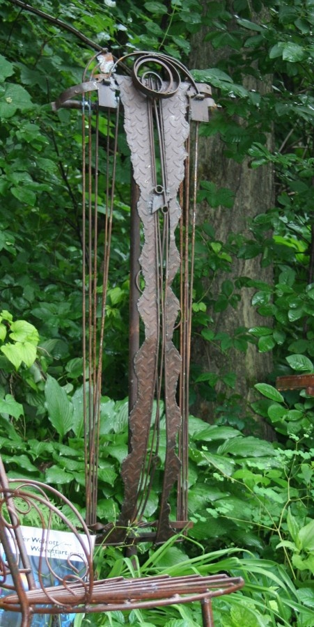 I love steel sculpture in the garden. Especially when created by a woman. We can think and create big! This by Jennifer Wolcott, MN.