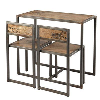 Issu de la collection Manufacture, cet ensemble de table et chaises de Maison du Monde reprend les codes graphiques d'un style industriel, pour donner du caractère à une pièce. Un mélange des matières de bois et métal, pour une finition brute.