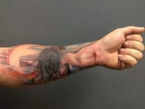 tattoo of jesus on the cross on man's arm | ... the rounds on facebook it is the arm of a man inscribed with a tattoo