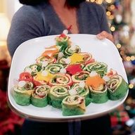 Christmas tree wraps. Use tomato, spinach and regular flavor wraps for 3 different kind of wrap. Spinach for turkey/cheese wrap.Tomato for ham cheese bacon wrap, etc.