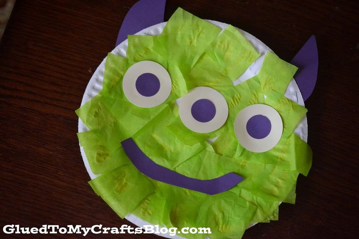 "Easy Alien {Kid Craft}  I decided a themed craft was in order. {because that's what crafty moms do} Which led into a search through my stash of supplies, looking for the perfect shade of green tissue paper. Then after an hour later of our time ""crafting"" we had this ""Easy Alien Craft"" displayed on our fridge. It's mainly inspired by those cute little aliens in the movie.  This would be a cute way to decorate a classroom especially if you had an outer space theme."