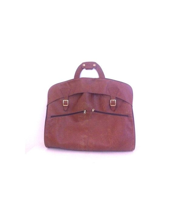 vtg. bull hide / leather garment bag. hanging by raspberryclothing, $89.00