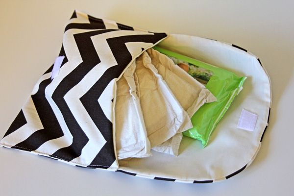 the chevron clutch tutorial + pattern - Uses home decor fabric on the outside and I have all that brown fabric that I bought for Angela's table runner, or even the blue ones..the inside is muslin cotton or something soft