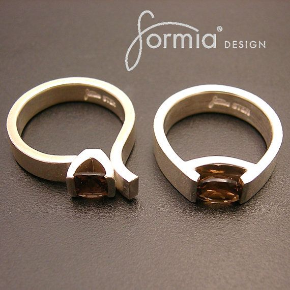 Special, comfortable, solid, modern and elegant ring.... non trditional engagement ring maybe? Formia designs signature ring hand fabricated in sterling silver and tension set with oval cut Smokey quartz 8mmx6mm(last picture other gemstones) Can be set with your choice of gemstone, please e-mail for price quote and request formia@live.com  Ring 6mm wide and 2mm thick