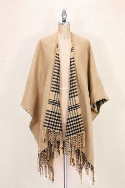 This gorgeous Waterfall Poncho is designed to keep the body warm when the temperatures drop, while at the same time, look fashionable and comfortable. Soft, lig