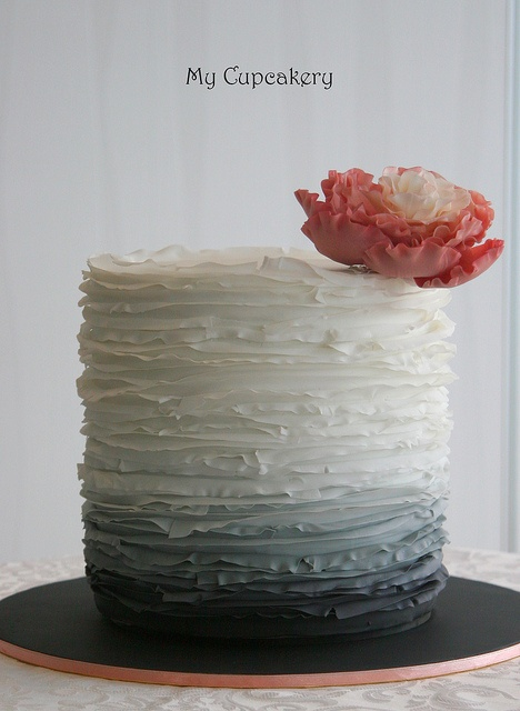 single tier -- simple and pretty. Spring Wedding Ruffle Cake by meggs2518, via Flickr