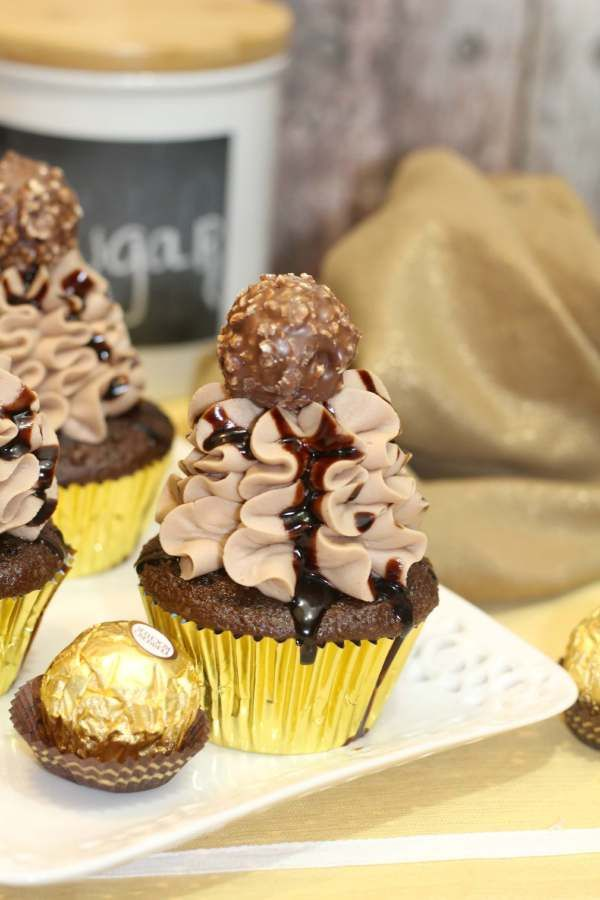 These are the ultimate in chocolatey goodness! Made from scratch chocolate cupcakes have bits of Ferrero Rocher candies inside and each cupcake is topped with a light and fluffy Nutella icing! The perfect holiday dessert! ~ http://serendipityandspice.com