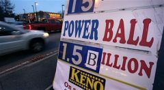 Commuters drive past a sign showing the Powerball jackpot in Wednesday's drawing is posted outside the Mobil Mart in Methuen, Mass., Tuesday, Jan. 12, 2016. (AP Photo/Charles Krupa)Ka-ching! Wednesday's Powerball jackpot soared to $1.5 billion as get-rich-quick mania seized America this week.