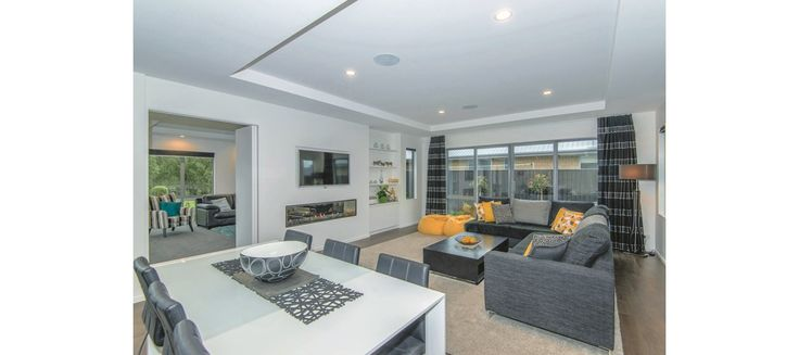 Open plan living area, with splashes of yellow