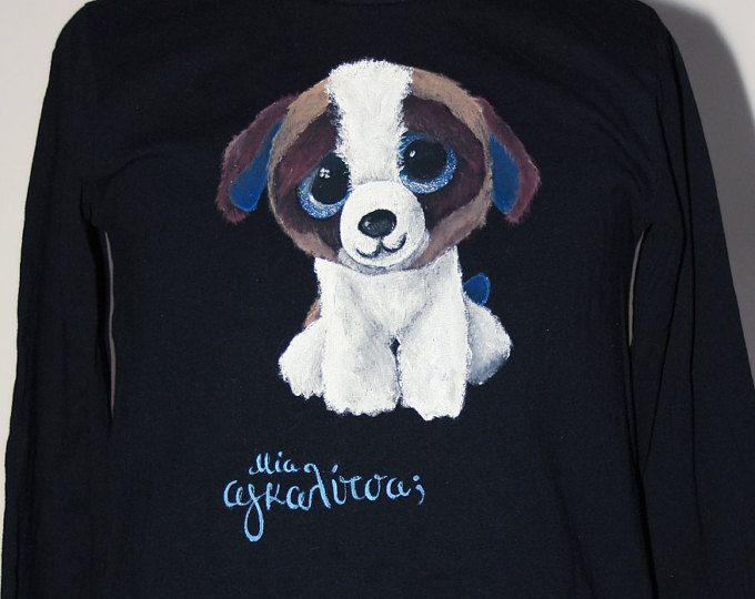 """Hand painted girl's t shirt. I use non-toxic, water based, permanent fabric colors. 100% organic cotton fabric. The caption reads """"A hug?"""" in Greek. This is my daughter's favorite plush toy - it's Duke the dog!"""