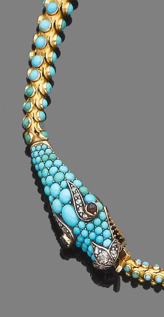 A turquoise, garnet and diamond serpent necklace, circa 1840 Modelled as a serpent biting its tail, the head pavé-set with cabochon turquoises and highlighted with cabochon garnet and rose-cut diamond eyes, length 39.8cm., cased by Hancocks of London.