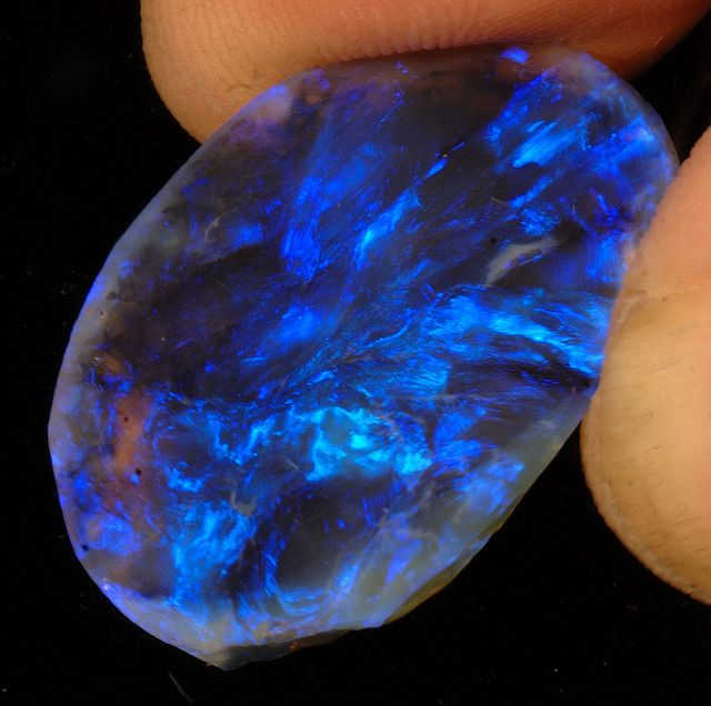 Lightning Ridge black opal.  http://www.flickr.com/photos/woodsstoneworksandphotofactory/2412732142/in/photostream/