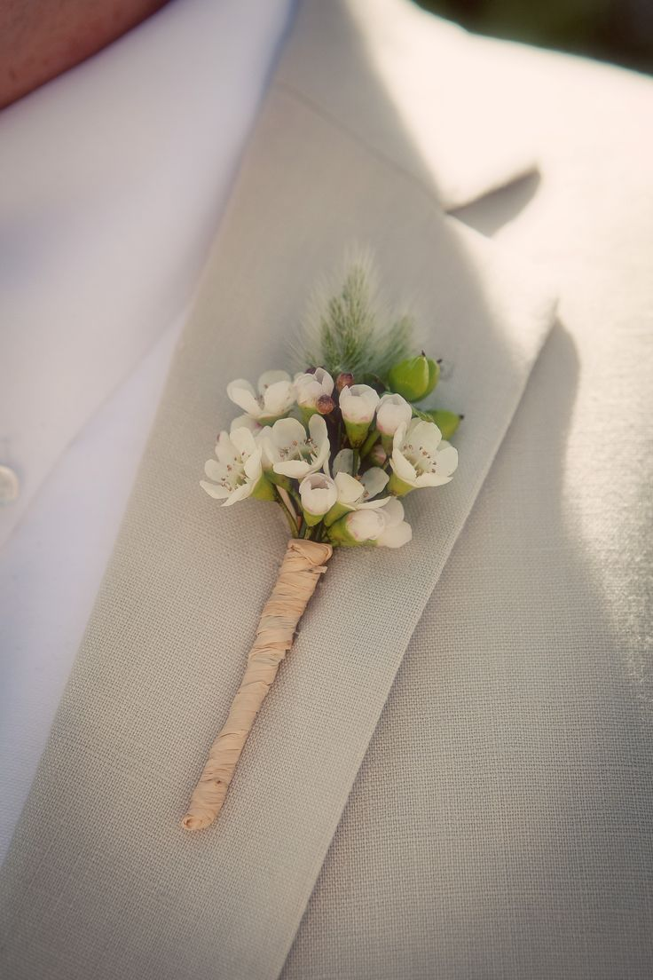 the wildflower look - wax flower boutonniere - wedding flowers - white http://whimsicalfloral.com