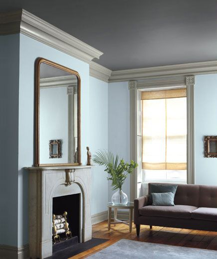 "Pale Blue, Dark Gray, Light Gray  A stormy ceiling and light gray woodwork take the sweetness out of baby blue. ""The darker tones keep the walls from seeming juvenile,"" says Ashcraft. She describes this palette as ""three shades of the sky."" The effect, in both the room (shown) and the collection (next page) of inspiration items above, is ""elegant and a bit Scandinavian."""