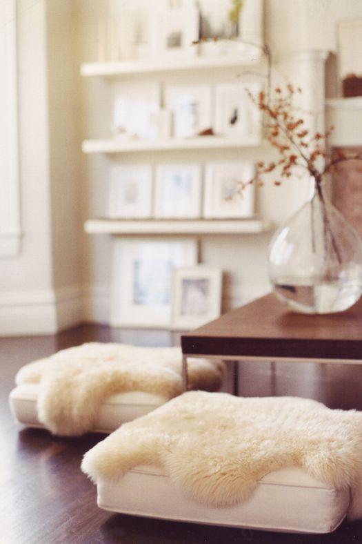 Floor cushions done glam; white on white photo ledges in background: Decor, Interior, Sheepskin, Idea, Floor Pillows, Livingroom, Living Room, Sheep Skin