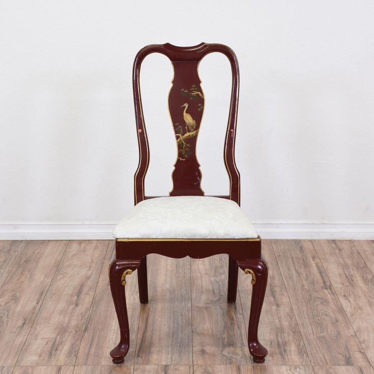 This Asian dining chair is featured in a solid wood with a walnut finish and is upholstered in a white fabric. This wooden chair features a bird illustration on the splat, cabriole legs with gold detailing, and a scallopeed apron. An elegant piece for the dining room! #asian #chairs #diningchair #sandiegovintage #vintagefurniture