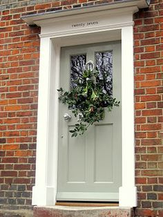 Light green front door, brick. Pretty sure this is the new front door color for the house!