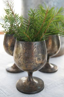 Lovely, greenery in tarnished silver cups.