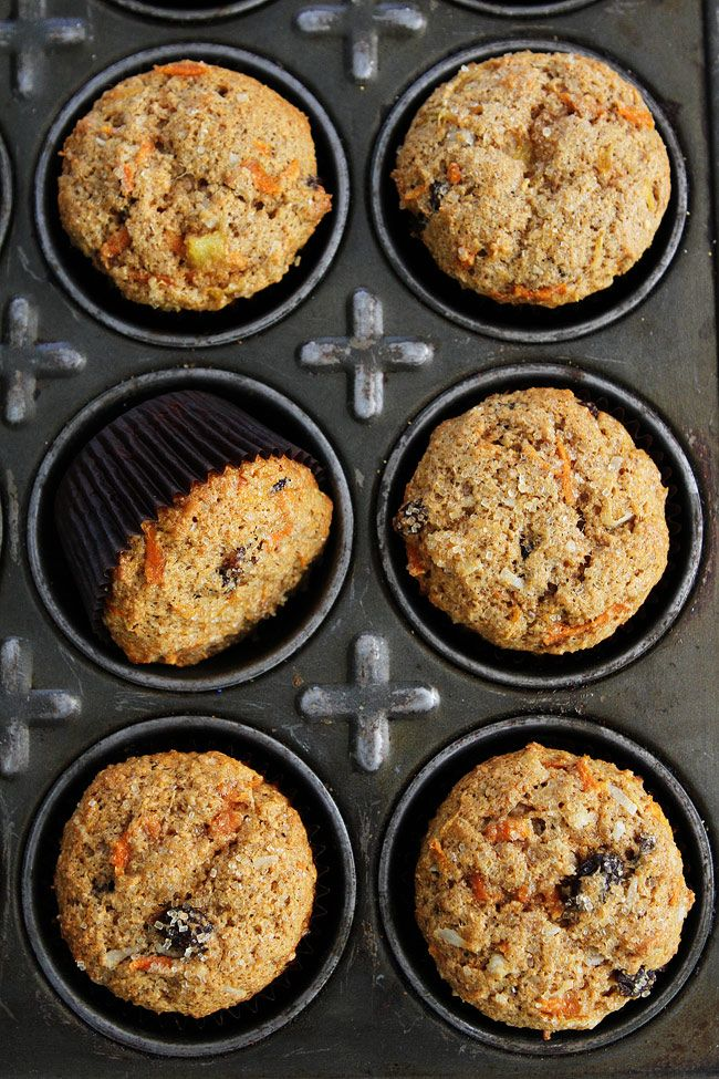 Morning Glory Muffin Recipe on twopeasandtheirpod.com Whole wheat muffins packed with pineapple, carrots, coconut, and raisins. These healthy muffins are great for breakfast on the go!