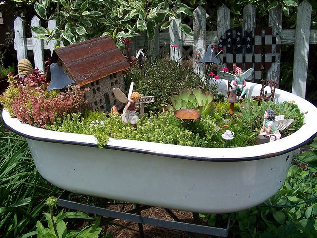 Fairy Garden in enamel dish - reminds me of bathtub! Wouldn't an old clawfoot tub make an AWESOME fairy garden? Love the little bee skep here too, and various details - by luvs2click, via Flickr - #fairy #garden #miniature