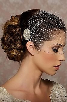 This is a gorgeous picture because we love the birdcage veils and her makeup is awesome too! www.beachbridalbeauty.com