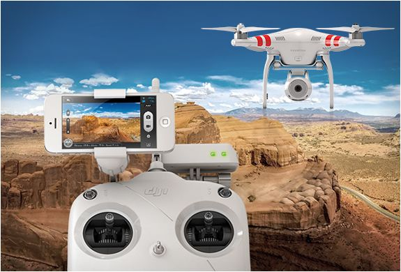 DJI Phantom 2 Vision. So cool. Helicopter with 14mp camera  iPhone interface. DJI Phantom Vision  #dji #phantomvision #quadcopter