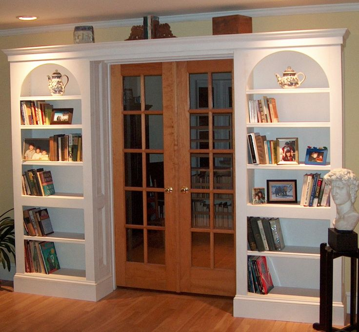 This Is Almost Perfect Execution Of The A I Had For Entrance Into Bathroom Just Normal Bookcases Though No Arch Also Pocket Door Instead