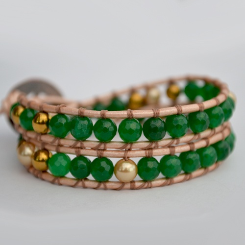 HB Blissdouble wrap has been designedwith beautiful facetedEmeralds, Gold Shell South Sea Pearls and Gold Hematite Gemstones. Onpearl metallic genuine leather, finished with a uniquecopper button clasp. Created to help yousucced inlife and specially in LOVE, living a blissful life.