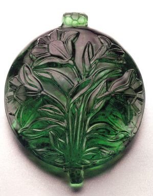 Carved emerald pendant, Mughal, India, 17th century.  In the collection of the Museum of Islamic Art, Qatar.