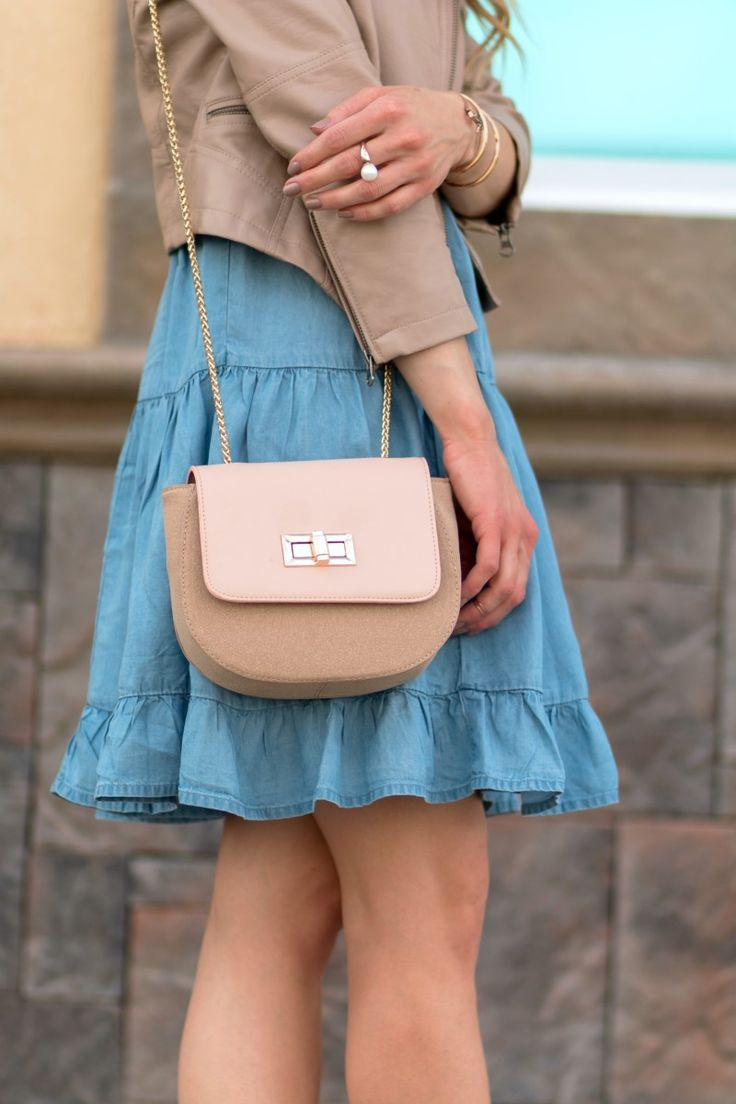 Need a neutral purse for summer? Try out a saddle bag in nude—not only is the shape the hottest style of the season, but the color goes with everything! See how blogger Glamour-Zine.com styles it: http://glamour-zine.com/one-chambray-denim-dress-styled-three-ways/