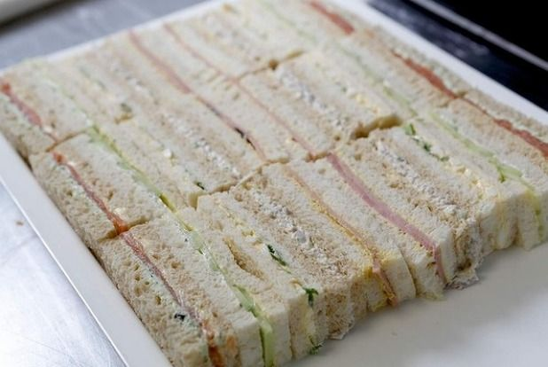 Step 14: Arrange the sandwiches in an alternating pattern, with fillings facing upwards.