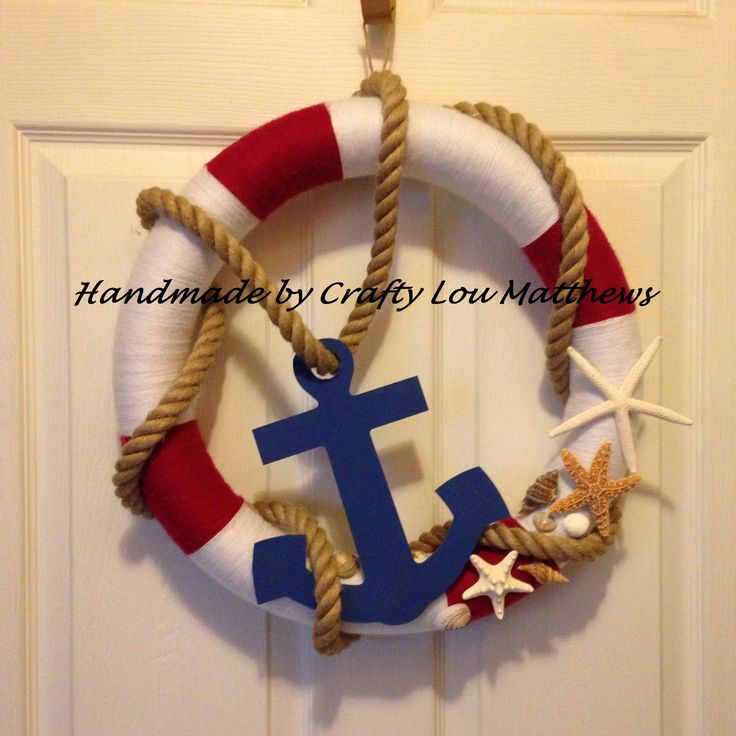 Handmade yarn pool noodle.  Featuring rope, starfish seashells and blue wooden anchor