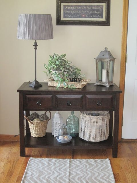 Baskets on lower shelf of entry table