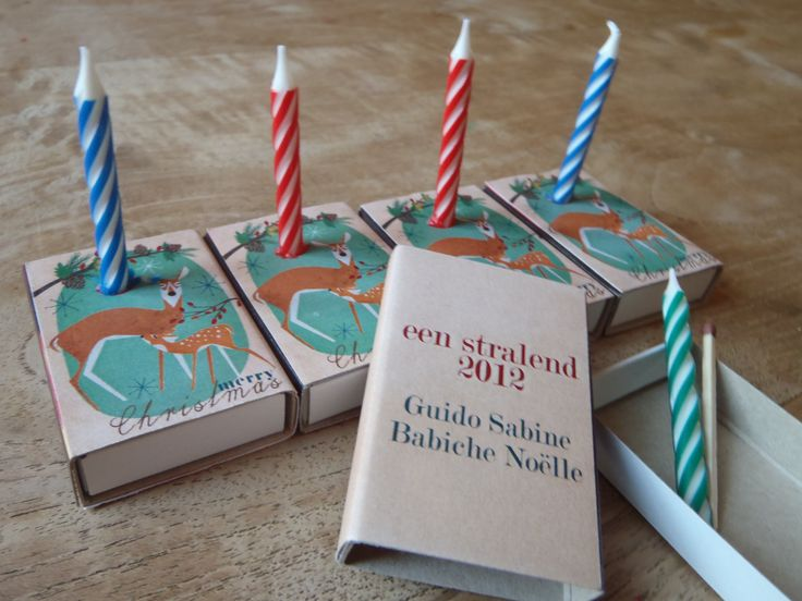 Christmas card idea: matchbox with Christmas wishes, a candle and a match. On the box it says: we wish you a bright 2012.