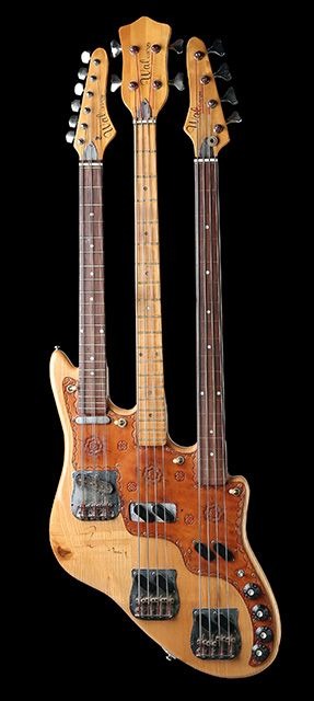 Triple-neck Wal bass designed by Rick Wakeman for Chris Squire. The bottom neck is fretless, the middle neck is a regular bass, and the top neck is a six-string Telecaster-style guitar that Squire refitted as a 3 double-string octave bass (tuned AA-DD-GG; blog.hardrock.com/). It's on display at Hard Rock Cafe Bucharest.